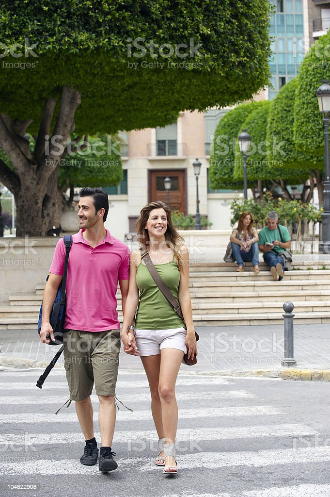 Tourist couple crossing road royalty-free stock photo