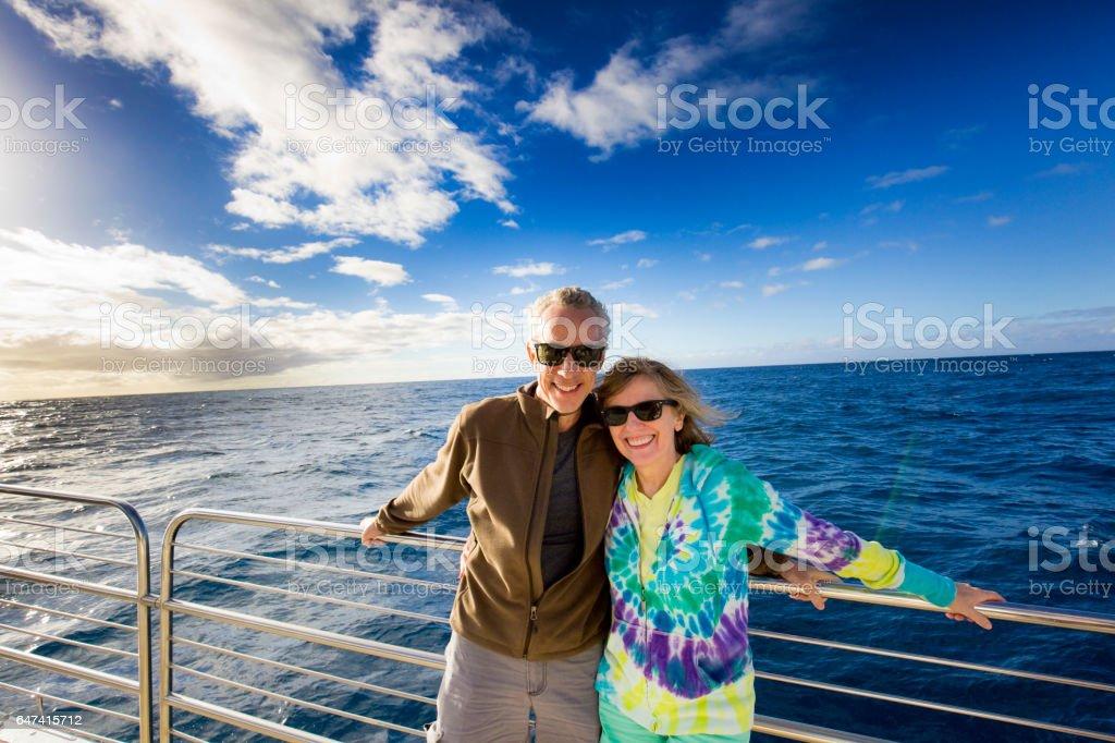 Tourist Couple in Cruise Ship Boat Tour stock photo
