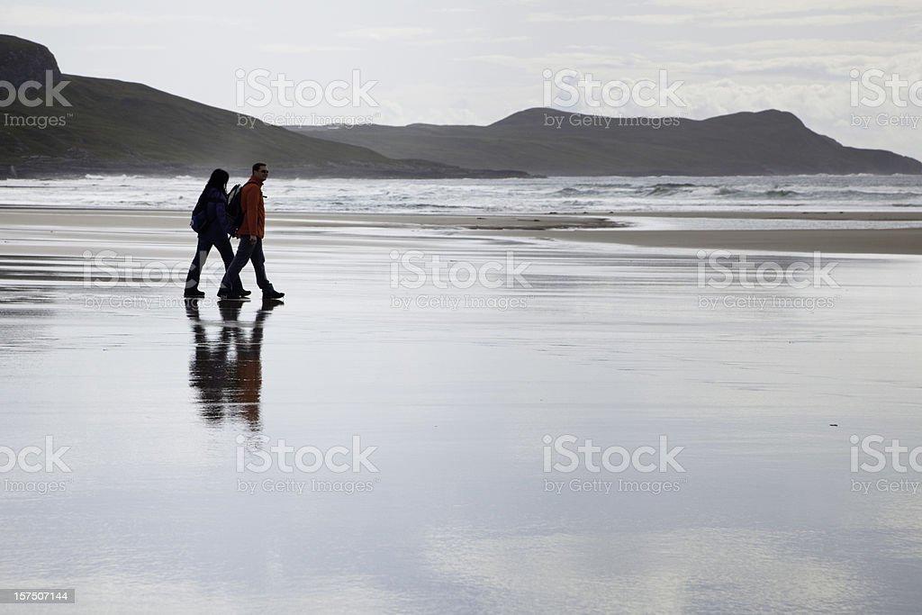 Tourist couple in Machir Bay, Islay, Scotland stock photo