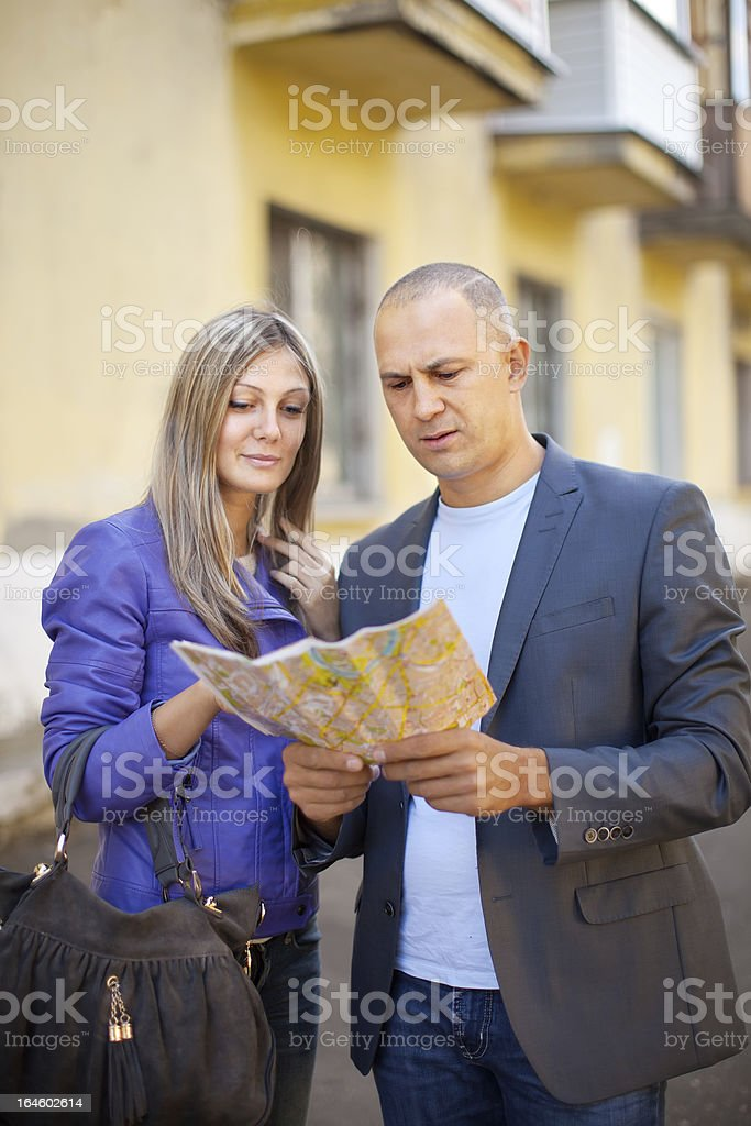 tourist couple looking at the map royalty-free stock photo