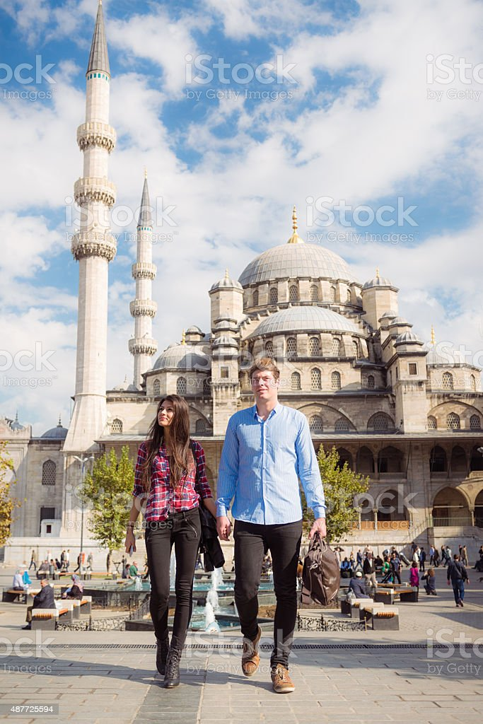 Tourist couple outside the Blue Mosque in Istanbul, Turkey stock photo