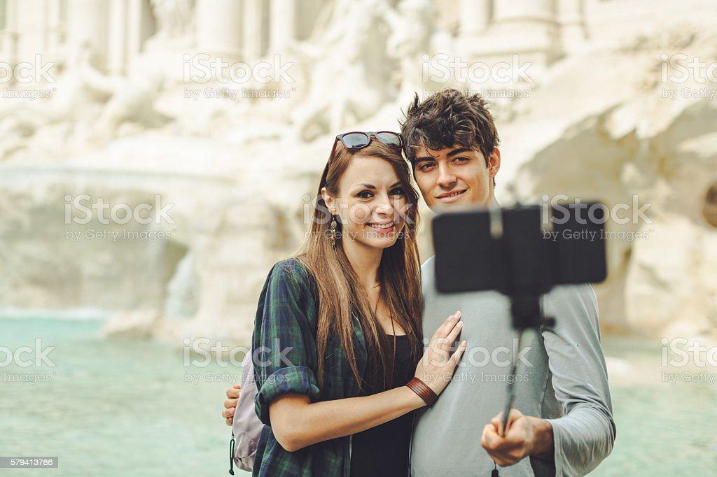 Tourist couple taking a selfie at Trevi fountain stock photo