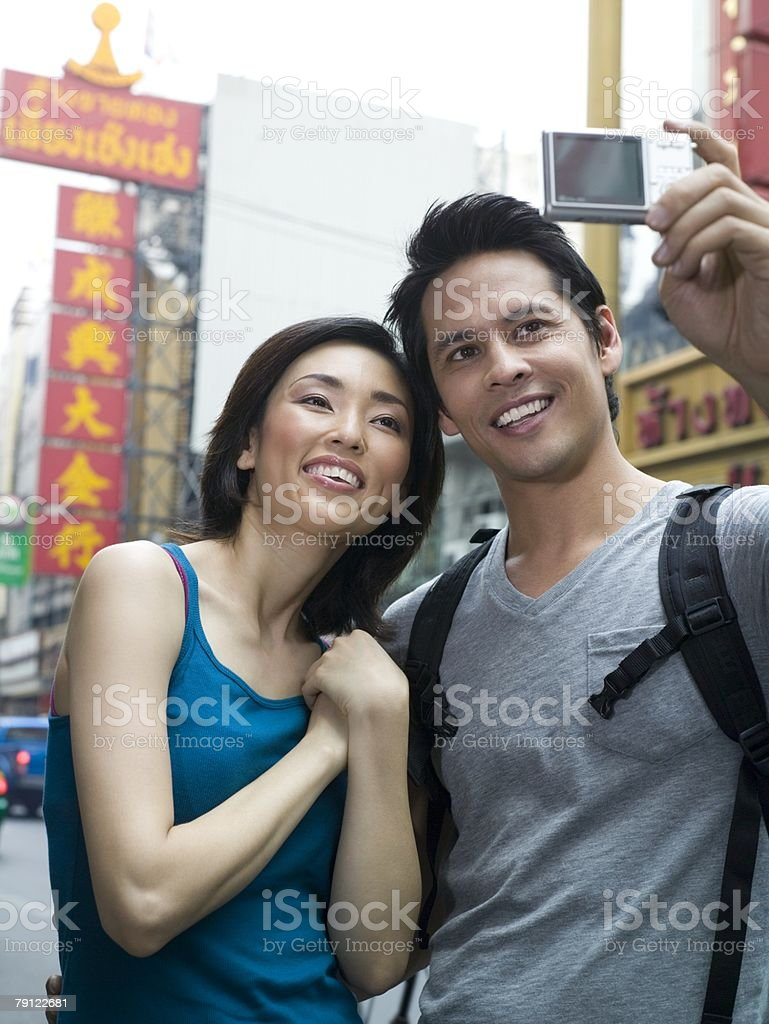 Tourist couple with camera royalty-free stock photo