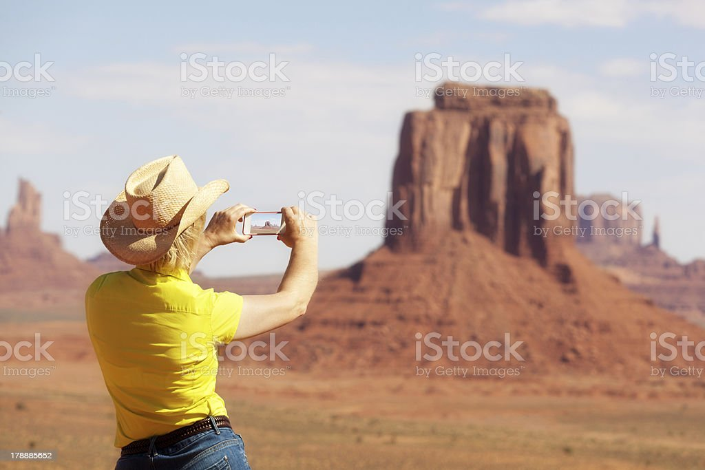Tourist Cowgirl Taking Picture of the American Southwest Monumnet Valley royalty-free stock photo