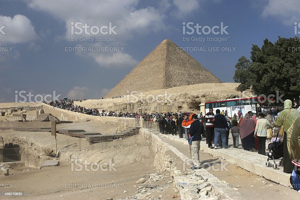 Tourist crowds at Pyramids of Giza royalty-free stock photo