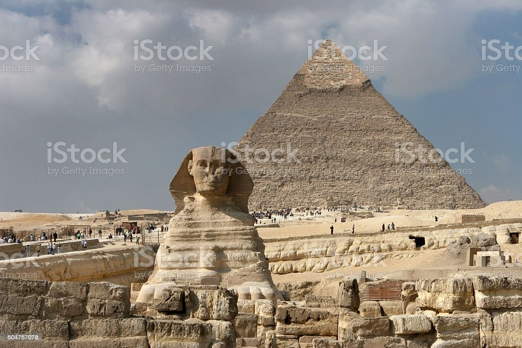 Tourist crowds explore Sphinx and Pyramids of Giza stock photo