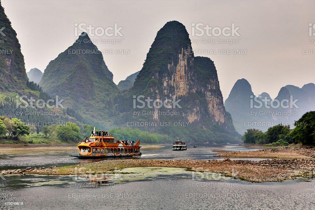 Tourist cruises on  Li River in Guilin, Yangshuo, Guangxi, China stock photo