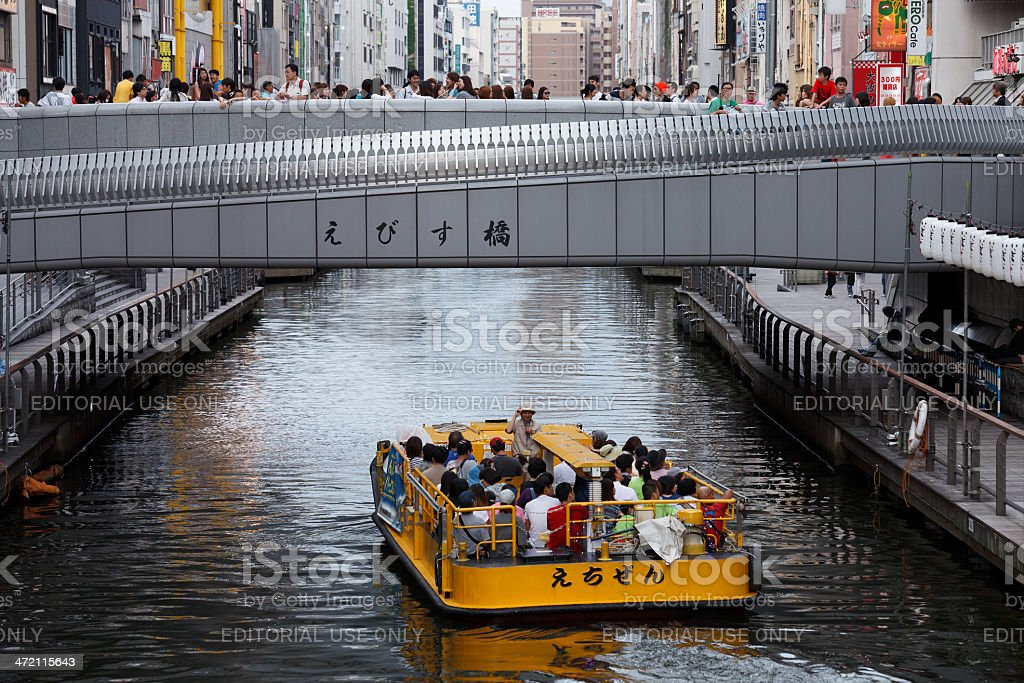 Tourist enjoy the boat ride in Dotonbori, Osaka stock photo