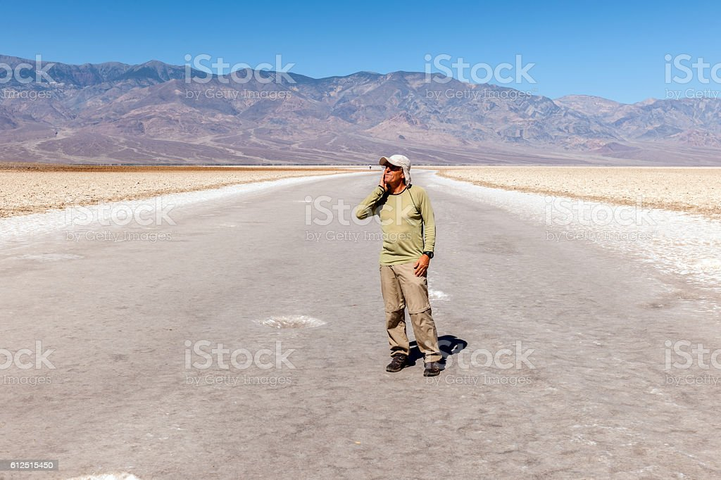 Tourist enjoying ,Badwater Basin in Death Valley California USA stock photo