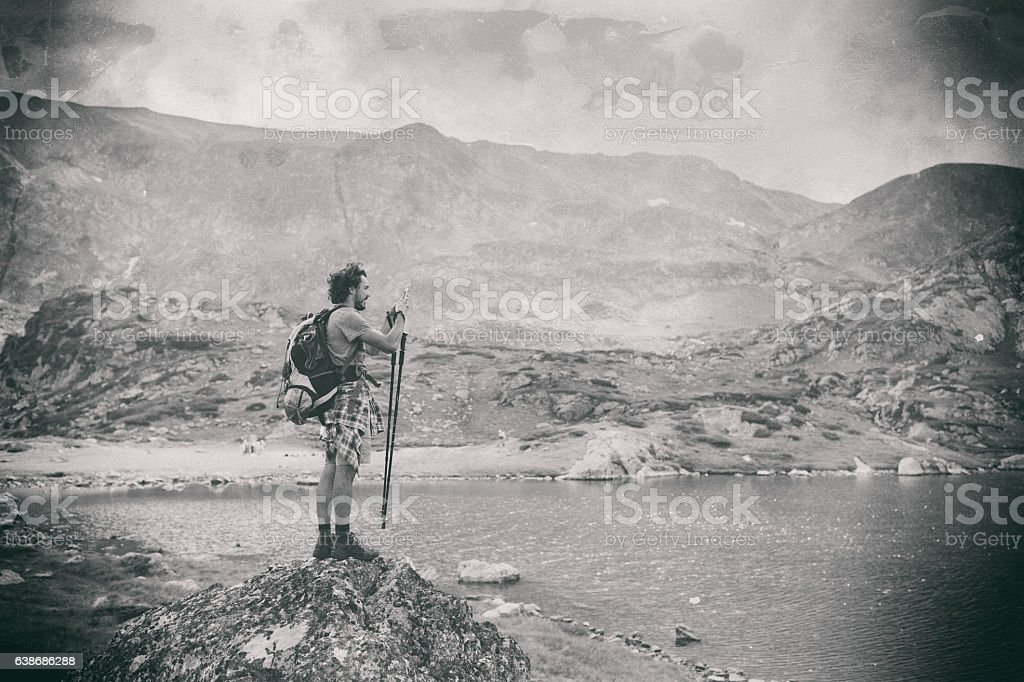 Tourist enjoying Rila mountains stock photo