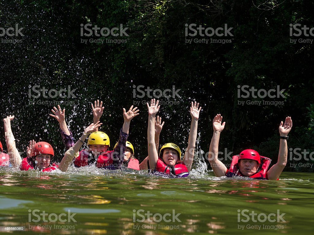 Tourist enjoying river water after rafting stock photo