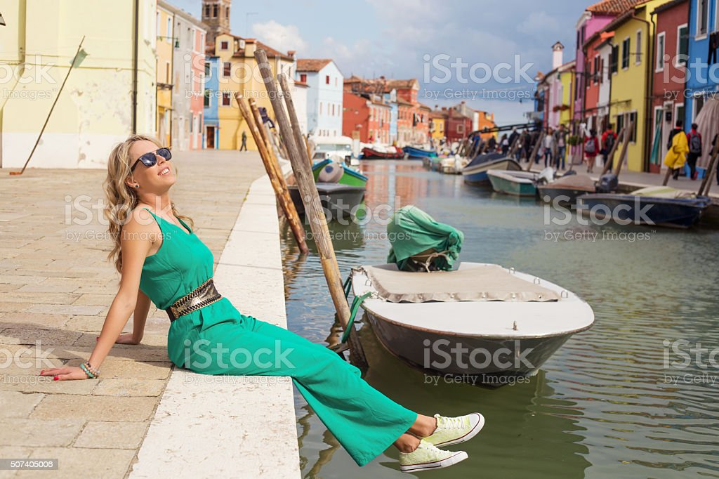 Tourist enjoying romantic Burano island of Venice in Italy stock photo