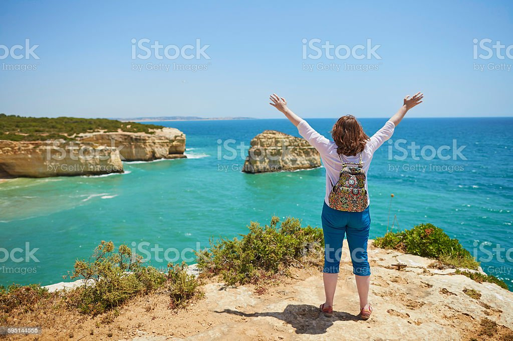 Tourist enjoying scenic landscape in Algarve, Portugal stock photo