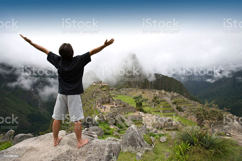 A tourist enjoying the scenery of Machu Picchu, Peru stock photo