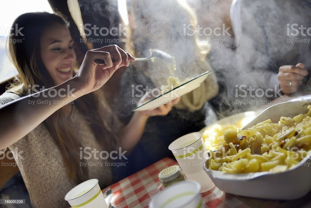 Tourist enjoying traditional Swiss meal Alplermagronen stock photo
