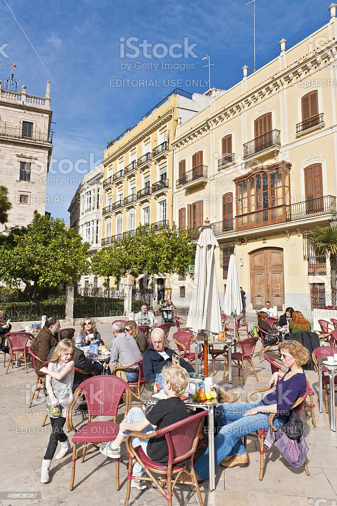 Tourist family sitting at pavement cafe Spain stock photo