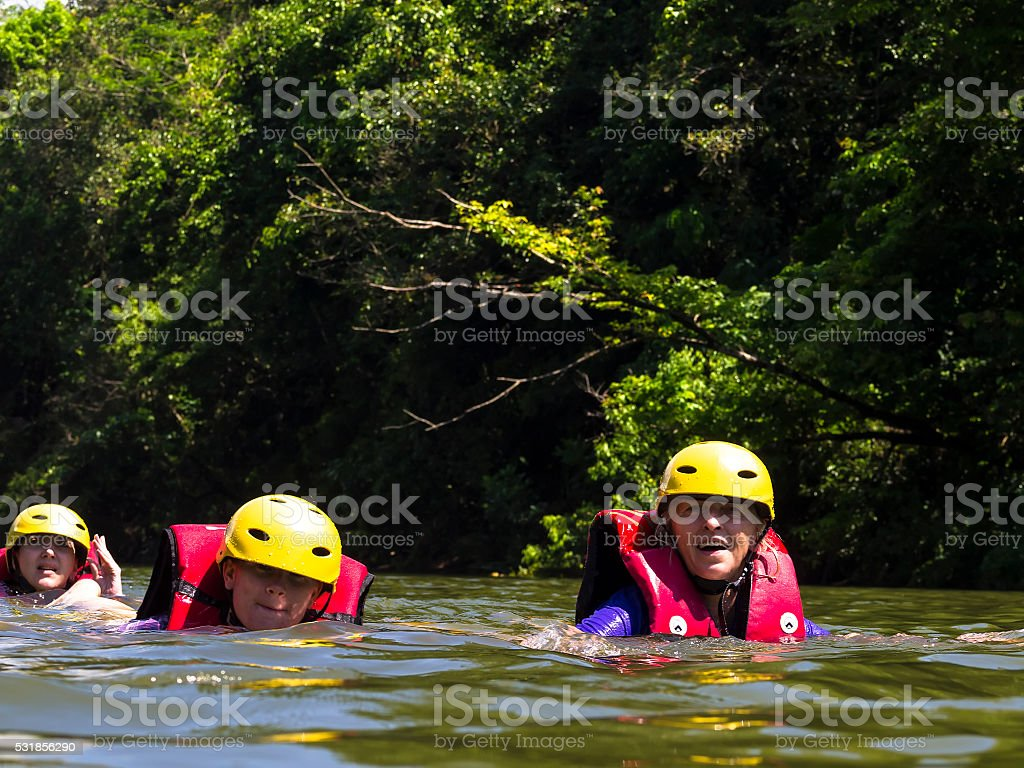 Tourist floating in river water after rafting stock photo