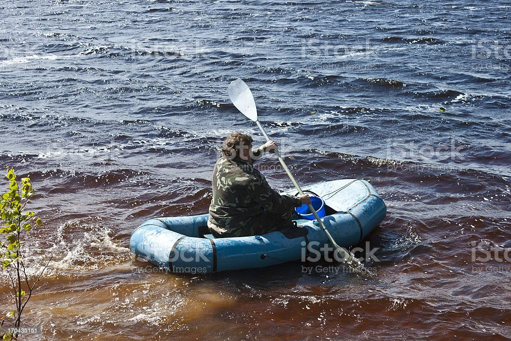 Tourist floats on a rubber boat royalty-free stock photo