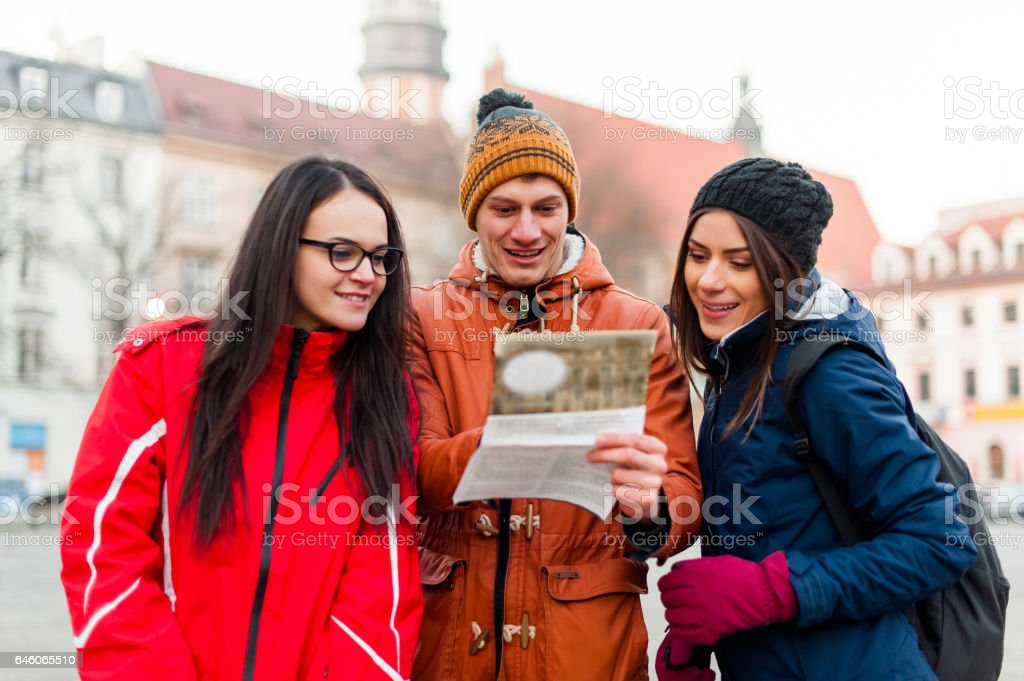 Tourist friends searching for directions stock photo