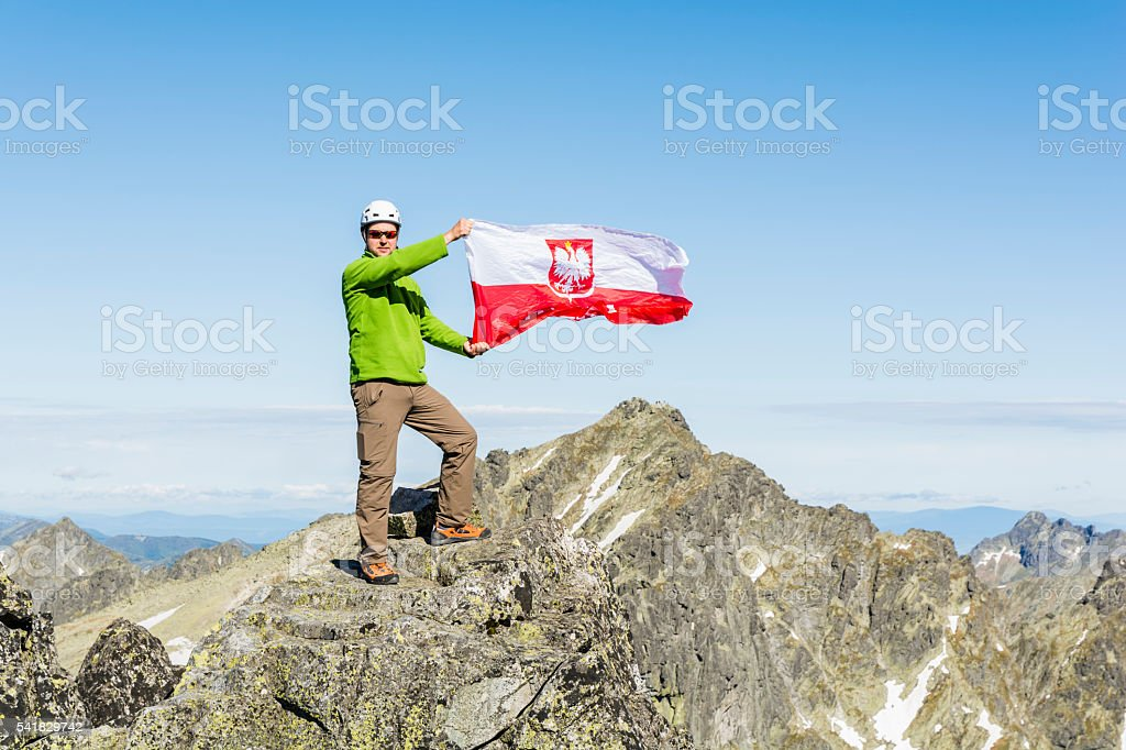 Tourist from Polish flag at the top. stock photo