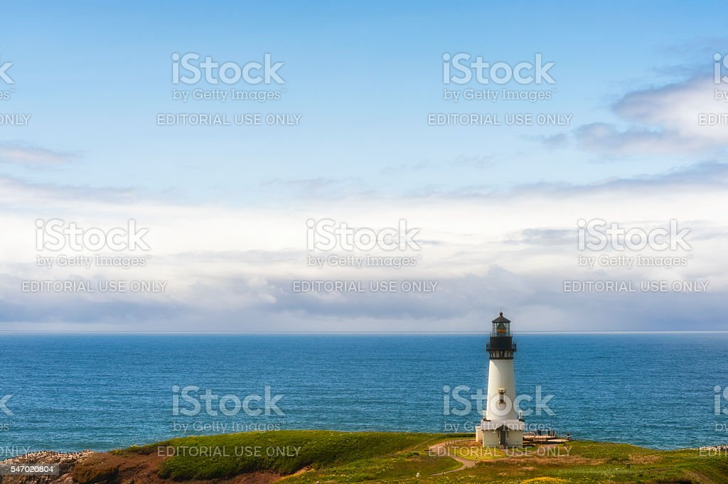 Tourist gather at base of Yaquina Head Lighthouse stock photo
