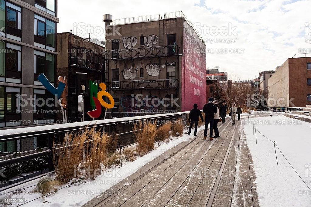 Tourist gather by the Urban Rattle Sculpture. High Line NYC stock photo