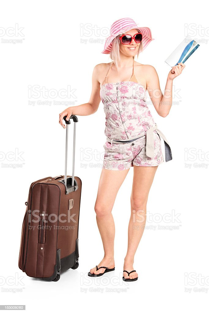 Tourist girl holding a ticket and suitcase royalty-free stock photo