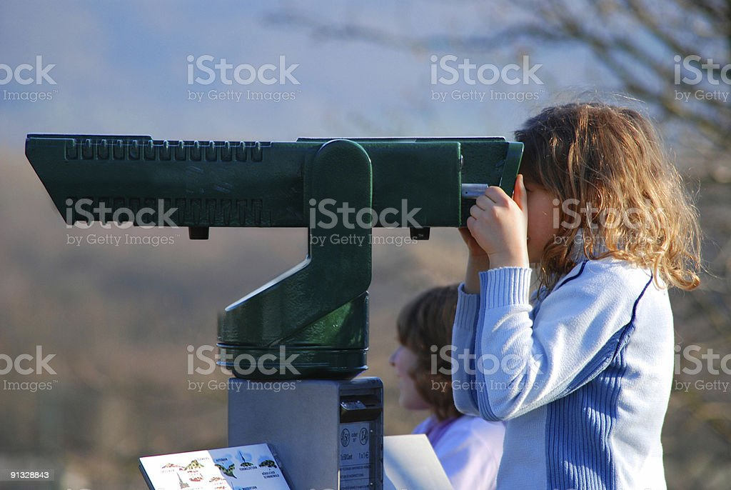tourist girl looking through telescope left royalty-free stock photo