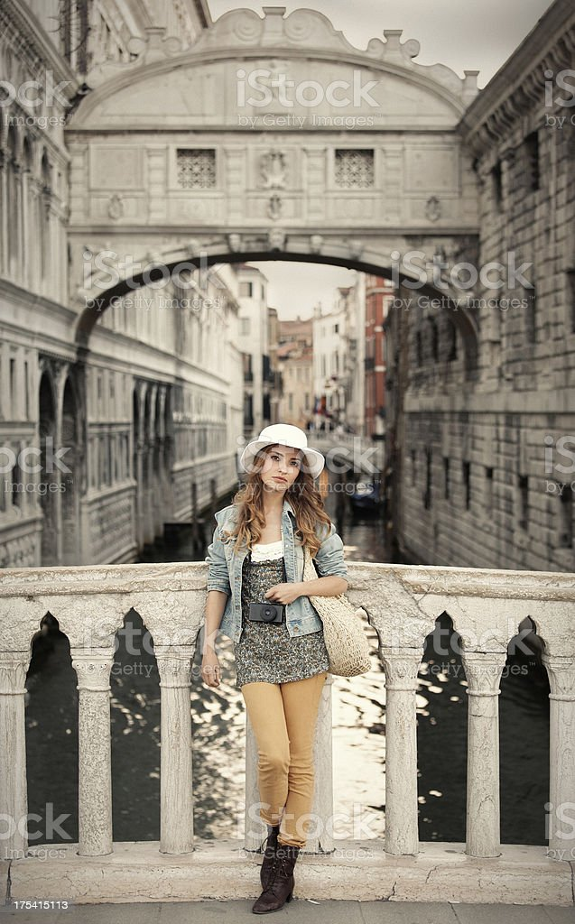 tourist girl posing before Bridge of Sighs in Venice royalty-free stock photo