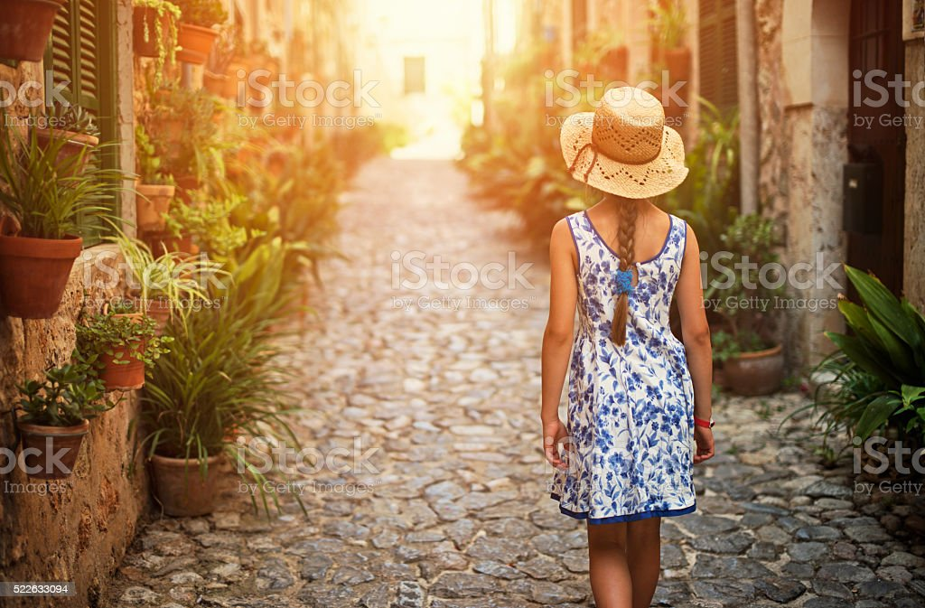 Tourist girl visiting mediterranean town. stock photo