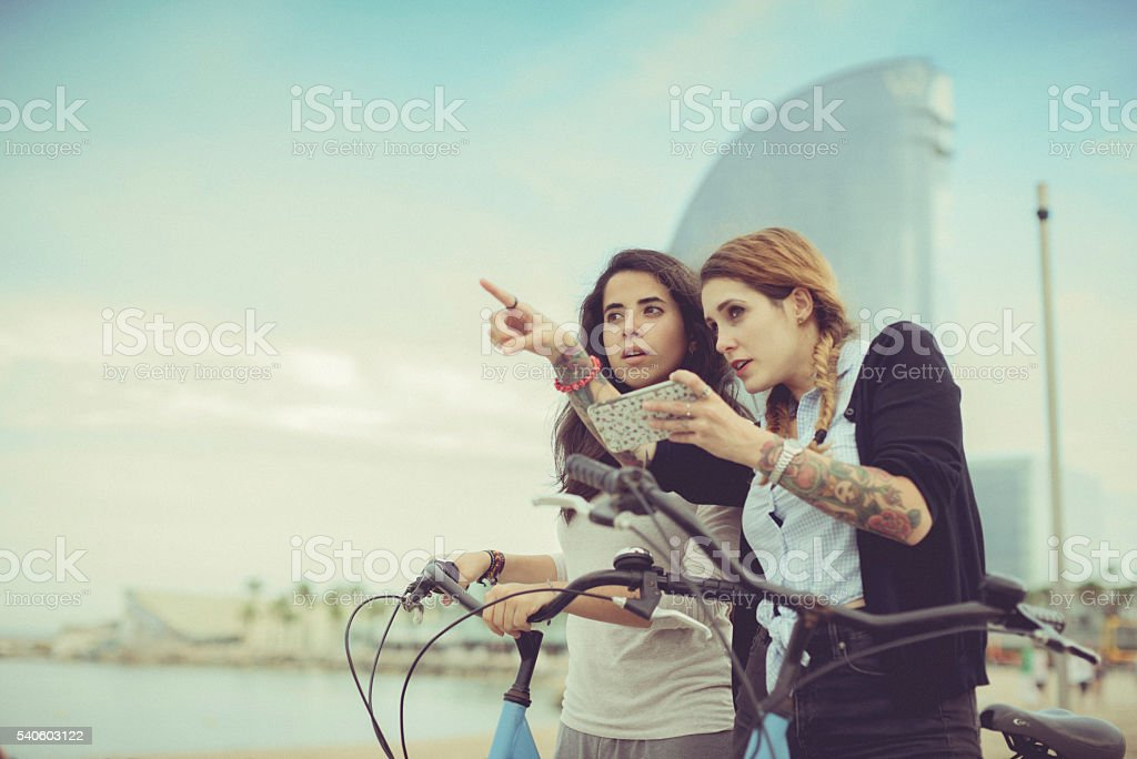 Tourist girls together social networking stock photo
