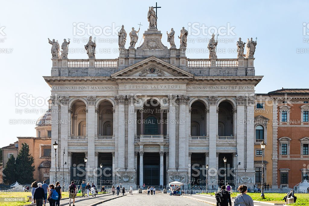 tourist go to Archbasilica of St. John in Lateran stock photo