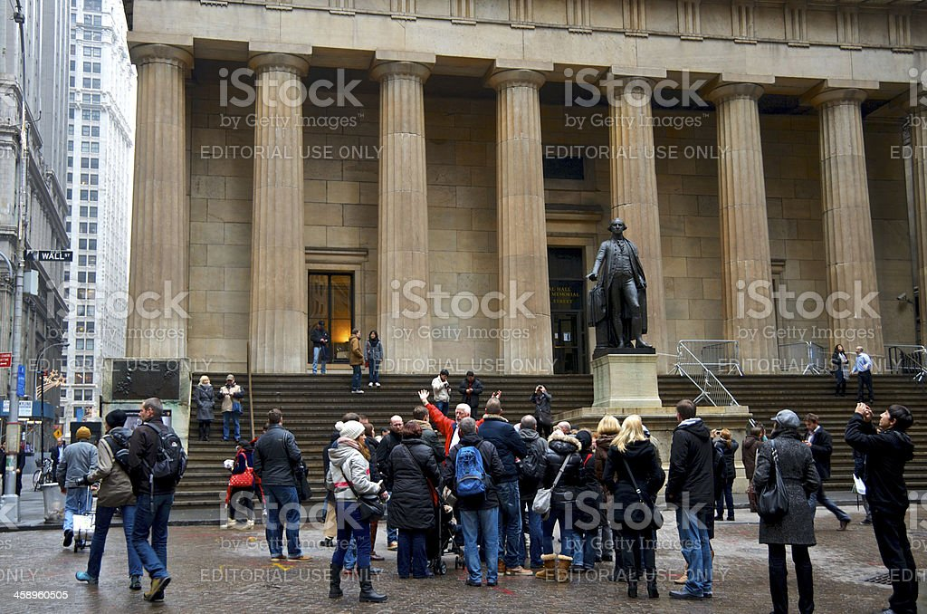 Tourist Group along Wall Street at Federal Hall, Lower Manhattan royalty-free stock photo