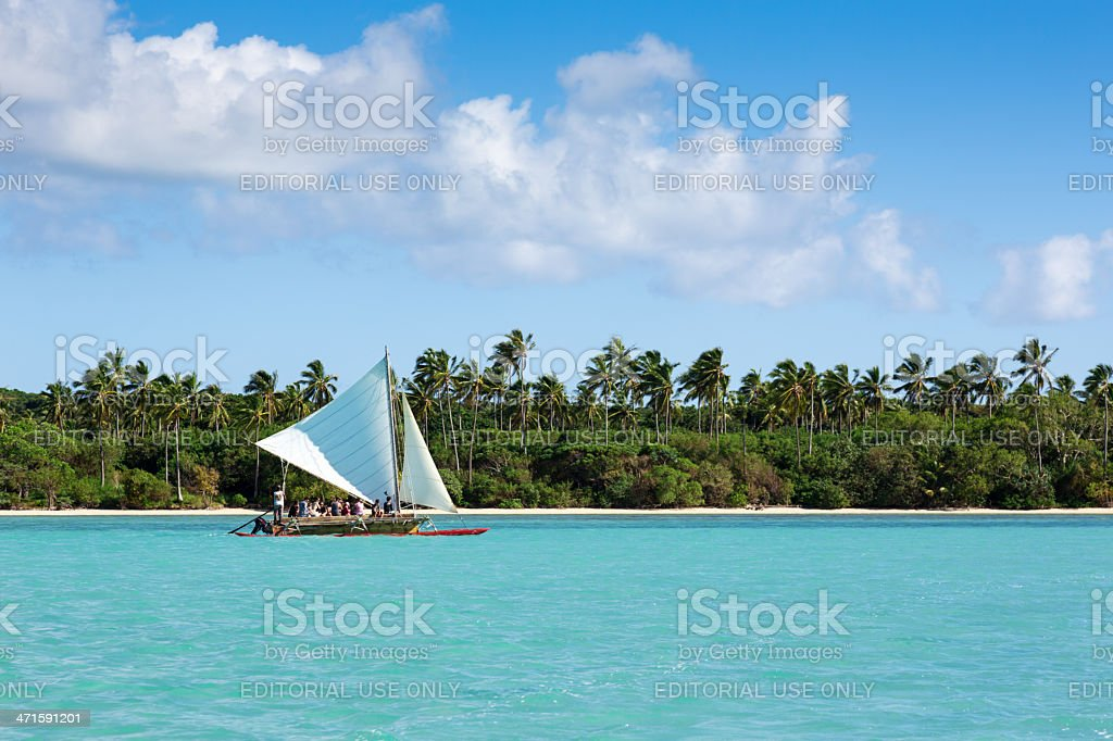 Tourist Group on Dugout Canoe, Isle of Pines, New Caledonia royalty-free stock photo
