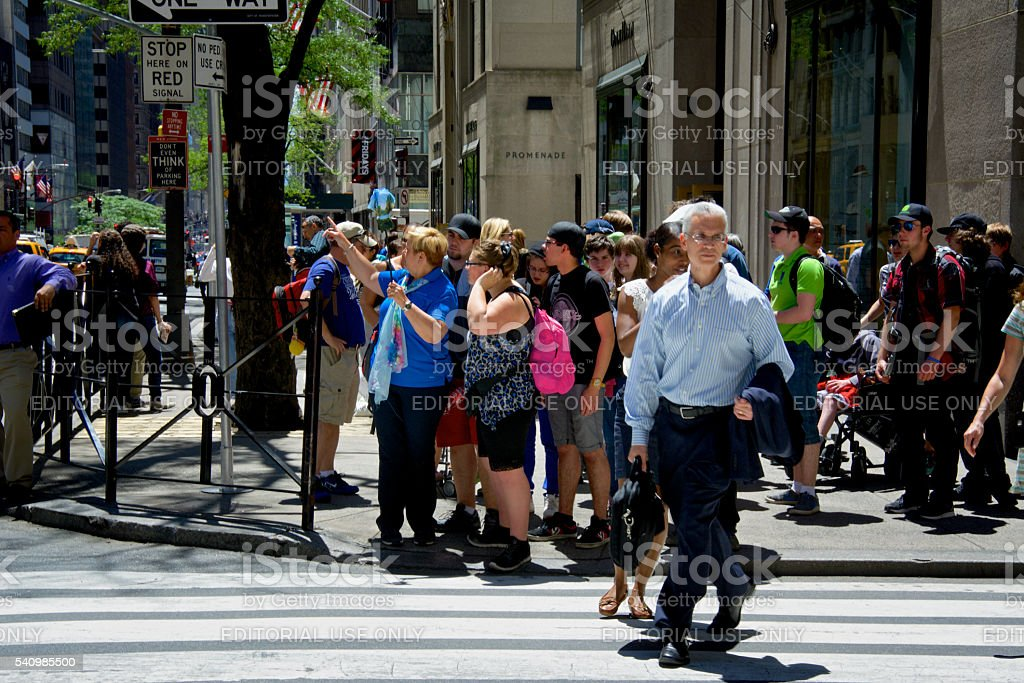 Tourist group stopped, looking around, 5th Ave., Midtown Manhattan, NYC stock photo