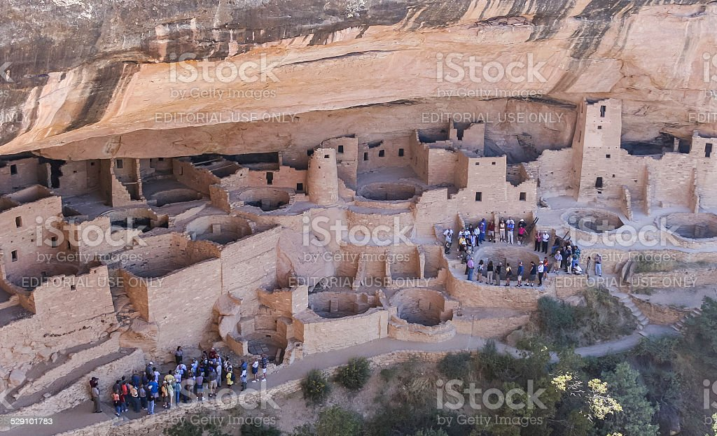 Tourist groups taking a tour in Mesa Verde stock photo