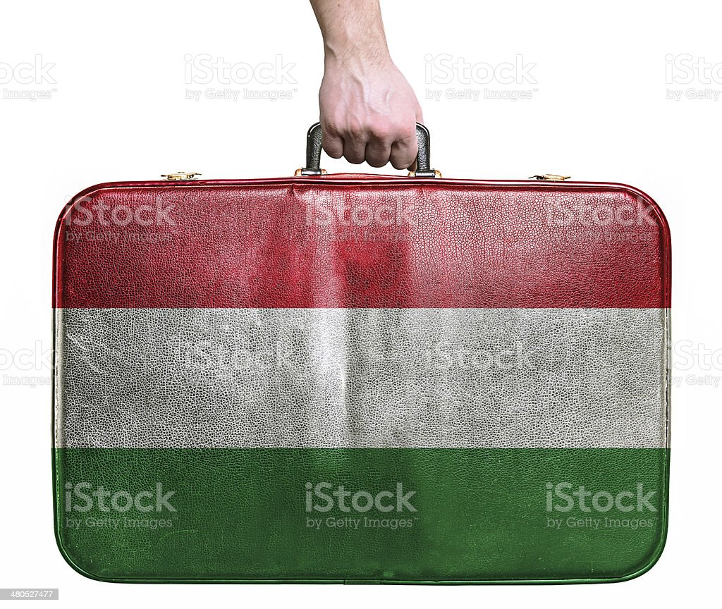 Tourist hand holding vintage travel bag with flag of Hungary royalty-free stock photo