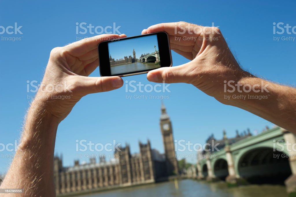 Tourist Hands Holding Camera Phone Taking Photo Big Ben London stock photo