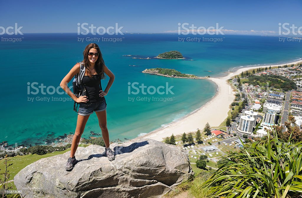 Tourist Hiker overlooking Mt. Maunganui, Bay of Plenty, New Zealand royalty-free stock photo
