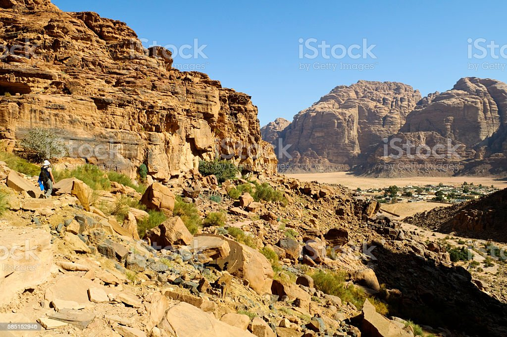 Tourist hiking in Wadi Rum, Jordan stock photo