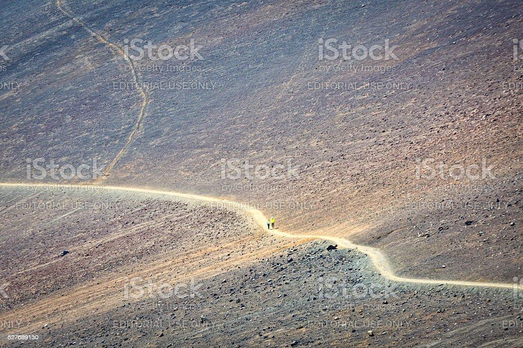 Tourist Hiking the Trail at Haleakala National Park Maui Hawaii stock photo