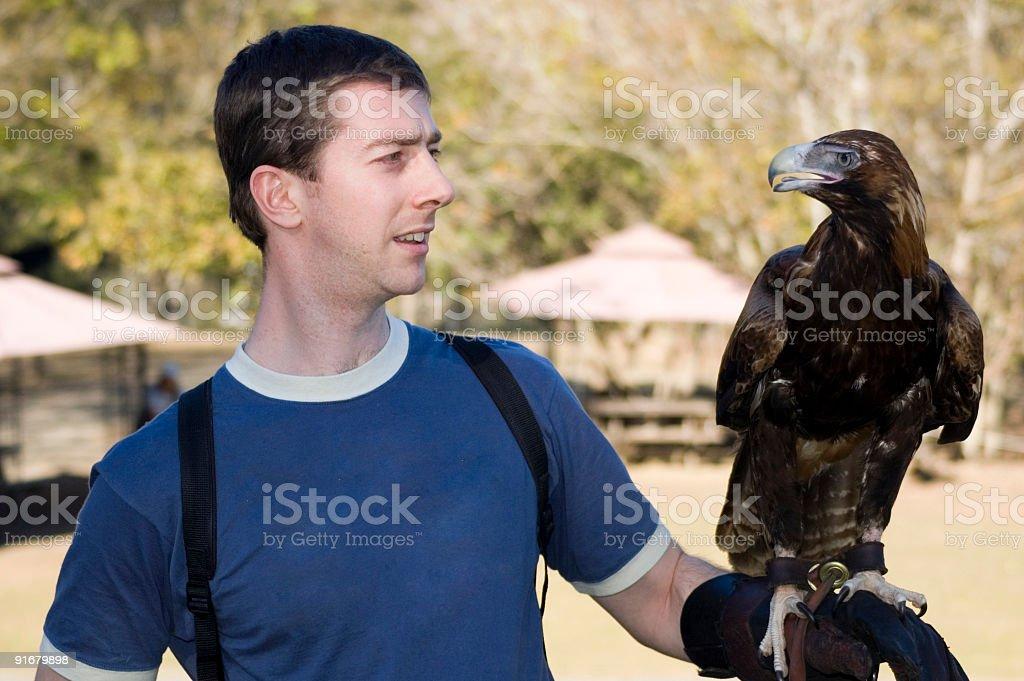 Tourist Holding an Eagle royalty-free stock photo