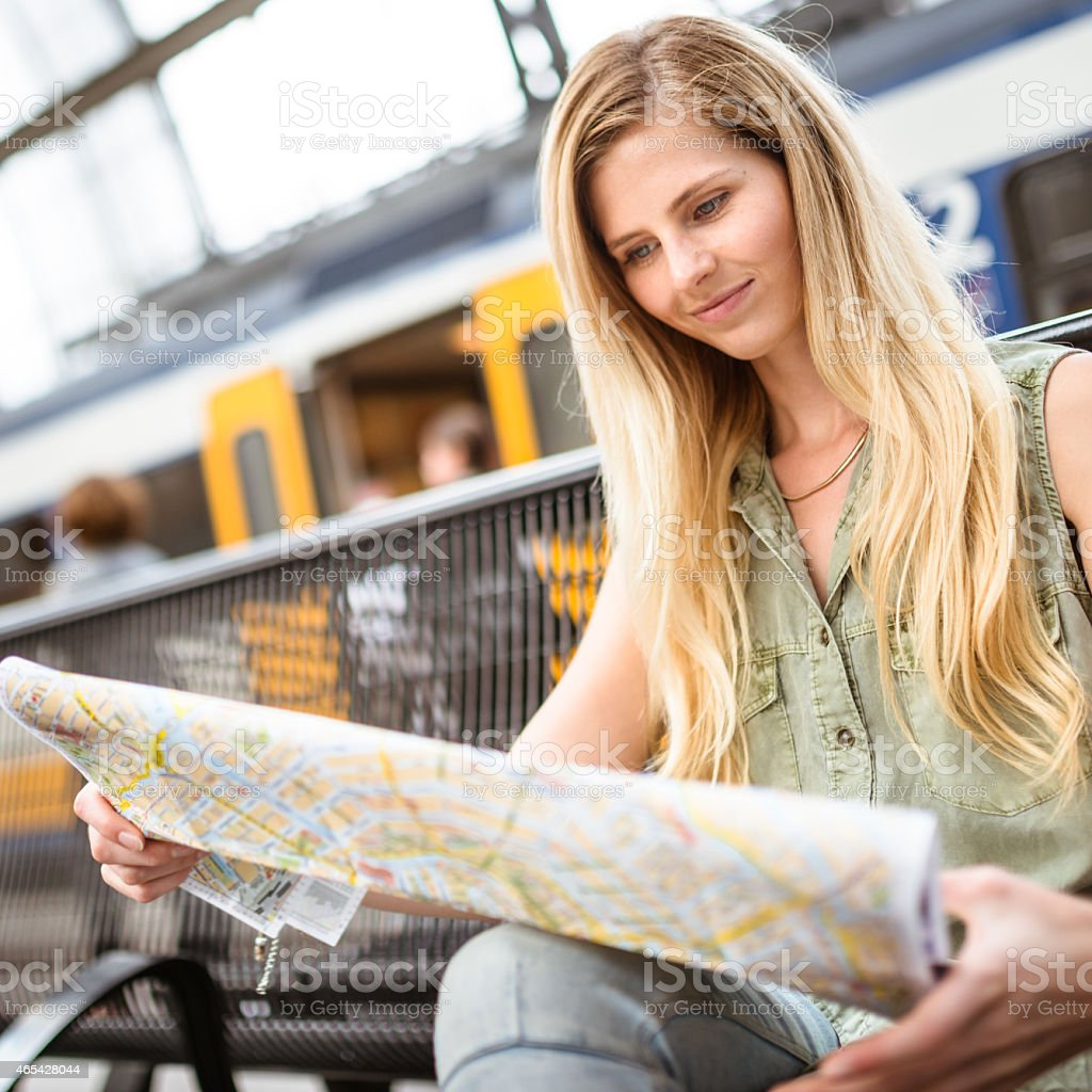 tourist in amsterdam looking map of the city stock photo