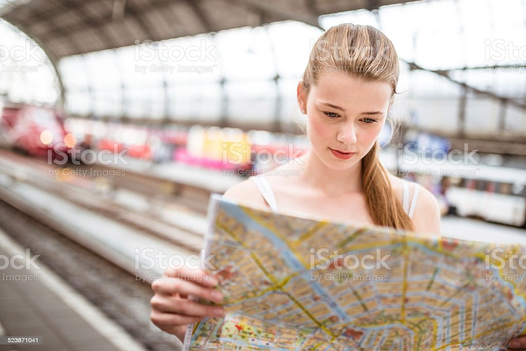 tourist in amsterdam station looking map of the city stock photo