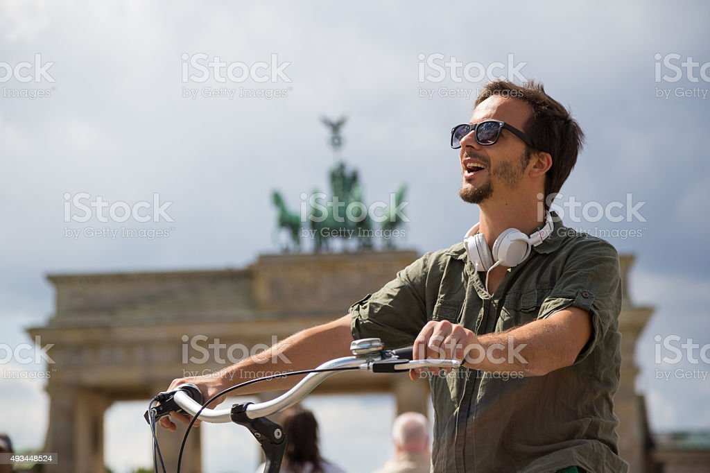 Tourist in Berlin on the bike stock photo