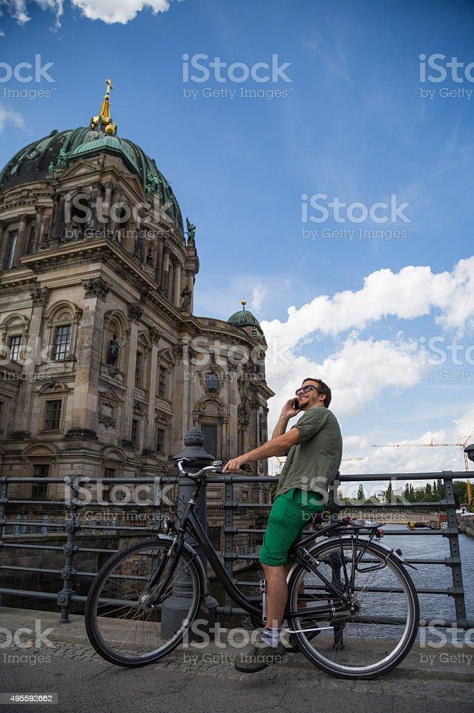 Tourist in Berlin on the bike stock photo