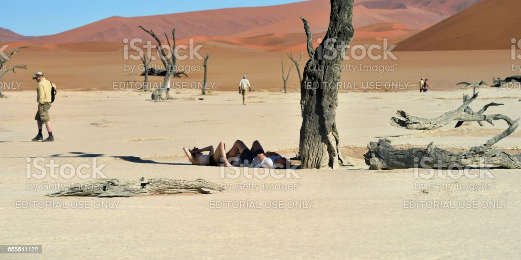 Tourist in Deadvlei, Namib-Naukluft National Park, Namibia, Africa stock photo