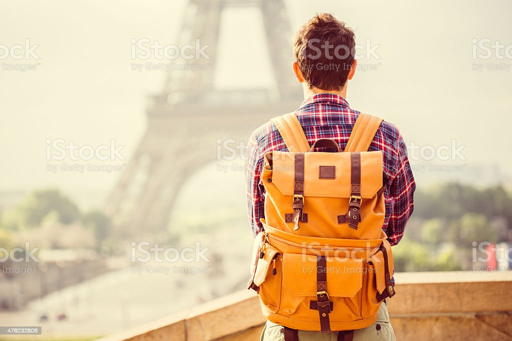 Tourist in front of an Eiffel Tower stock photo