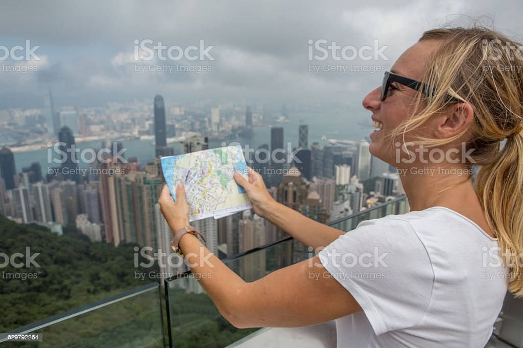 Tourist in Hong Kong looks at map stock photo