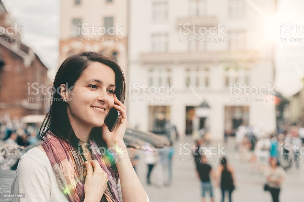 Tourist in Krakow talking by the phone stock photo